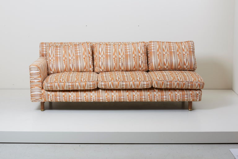 Rare sectional sofa designed by Edward Wormley, manufactured by Dunbar. The sofa consists of three parts - two three-seater and one one-seater - which can be put together arbitrarily. It comes on wood legs and a total of seven back and seven seat