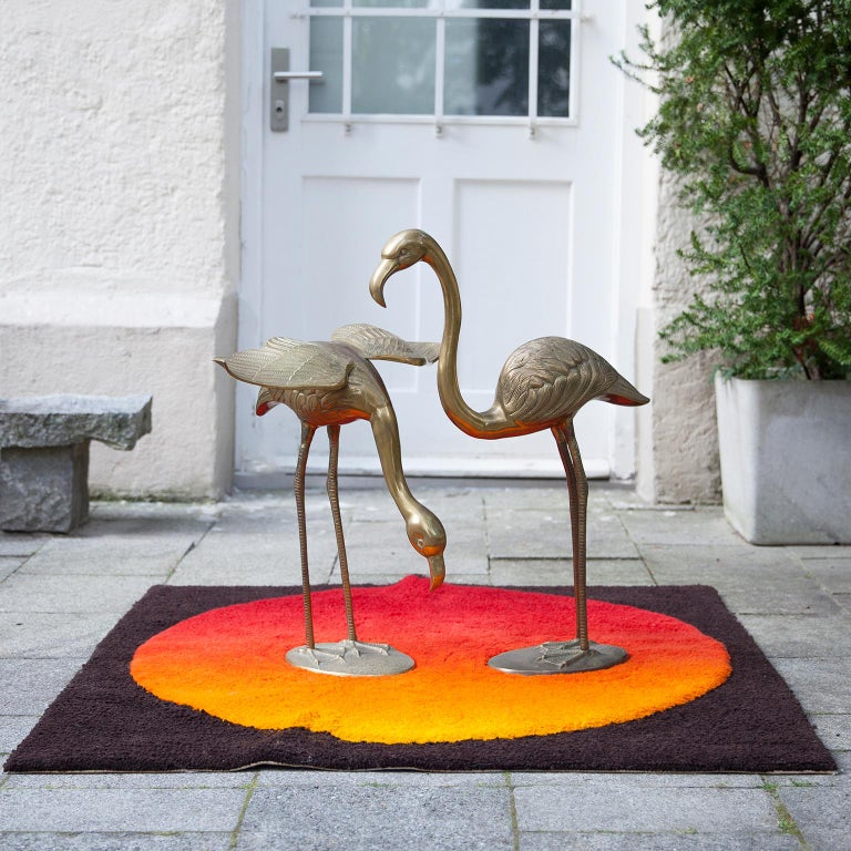 Set of two huge flamingo sculptures made in solid brass. Hollywood Regency style glamour at its best.  Measures: 76.5 H x 53 B x 18.5 D cm  56 H x 38 B x 64 D cm.