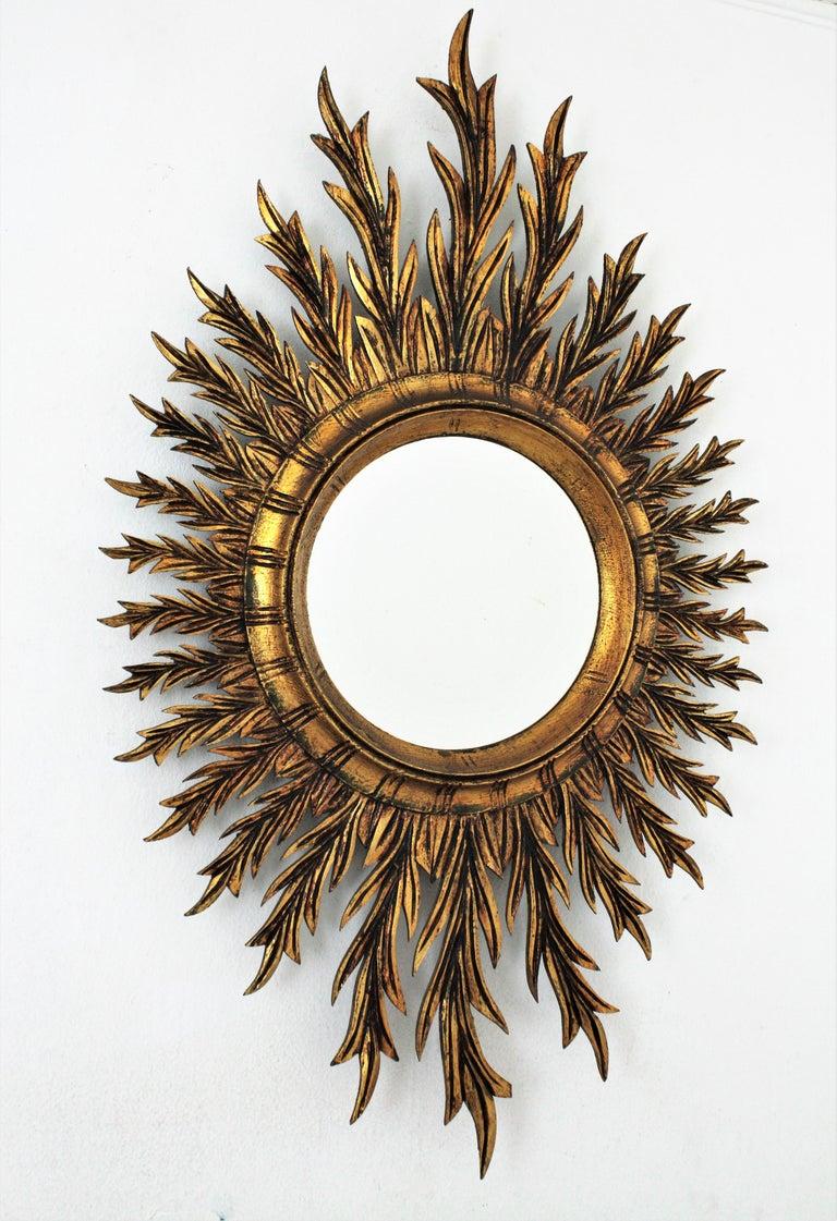 Mid-Century Modern Giltwood Oval Sunburst Mirror, 1950s For Sale
