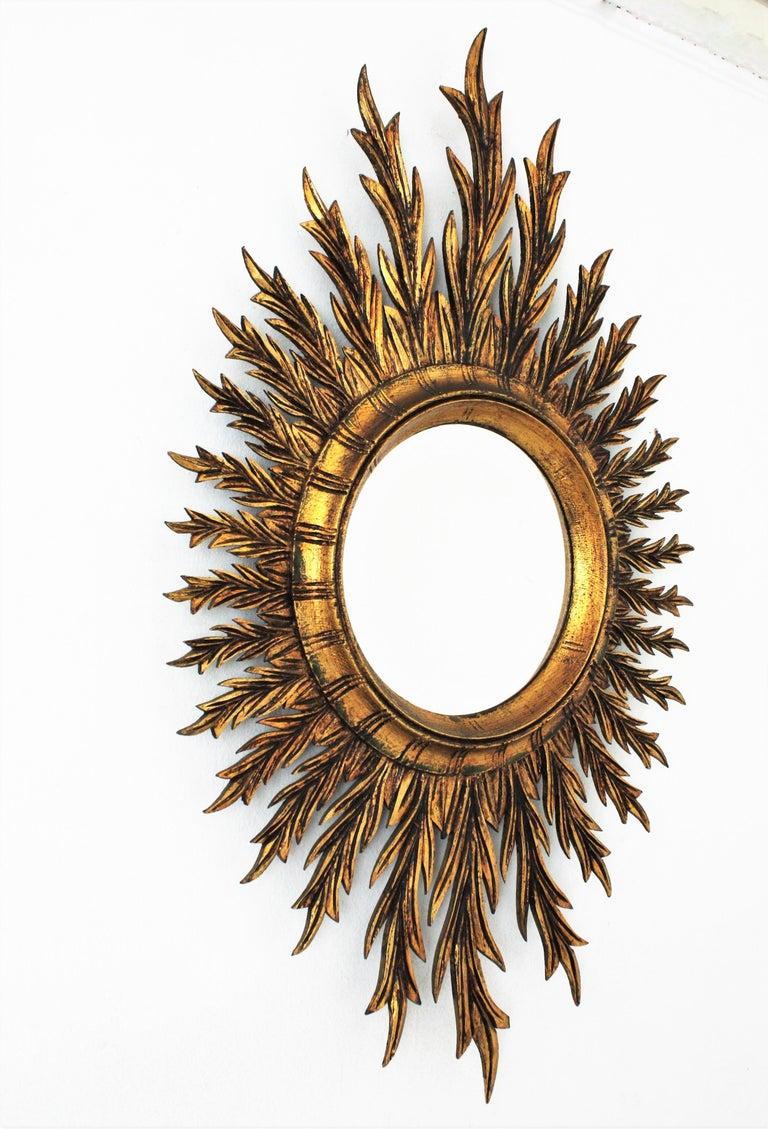 Spanish Giltwood Oval Sunburst Mirror, 1950s For Sale
