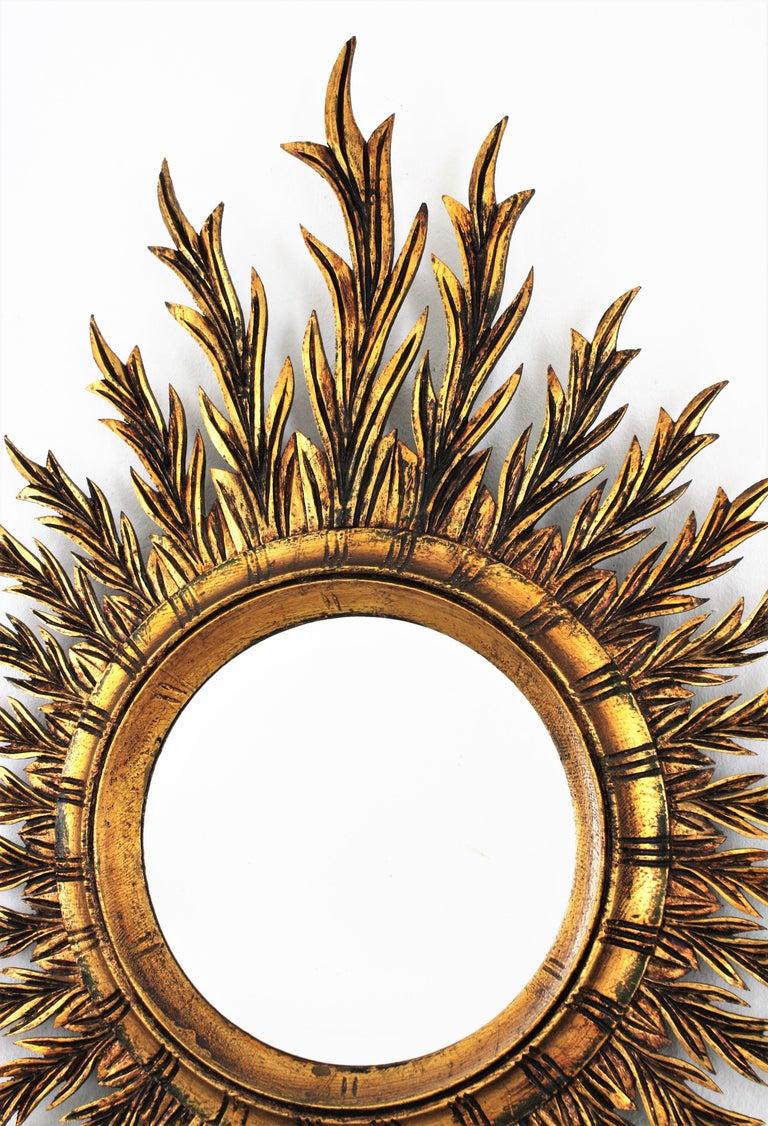 Carved Giltwood Oval Sunburst Mirror, 1950s For Sale