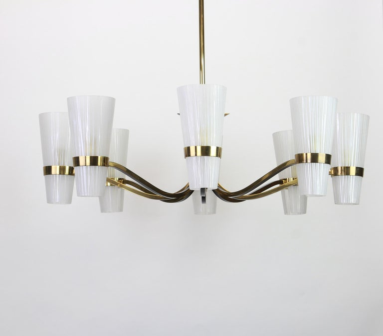 Stunning midcentury sunburst chandelier, in Stilnovo style made in the 1950s.