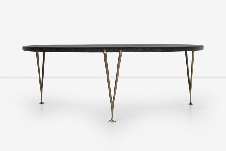 Hugh Acton cocktail table with black granite top with inlaid quartz coffee table, solid brass legs.  Stone top 39.5 is the diameter of the stone table. The legs extend out approximately 1