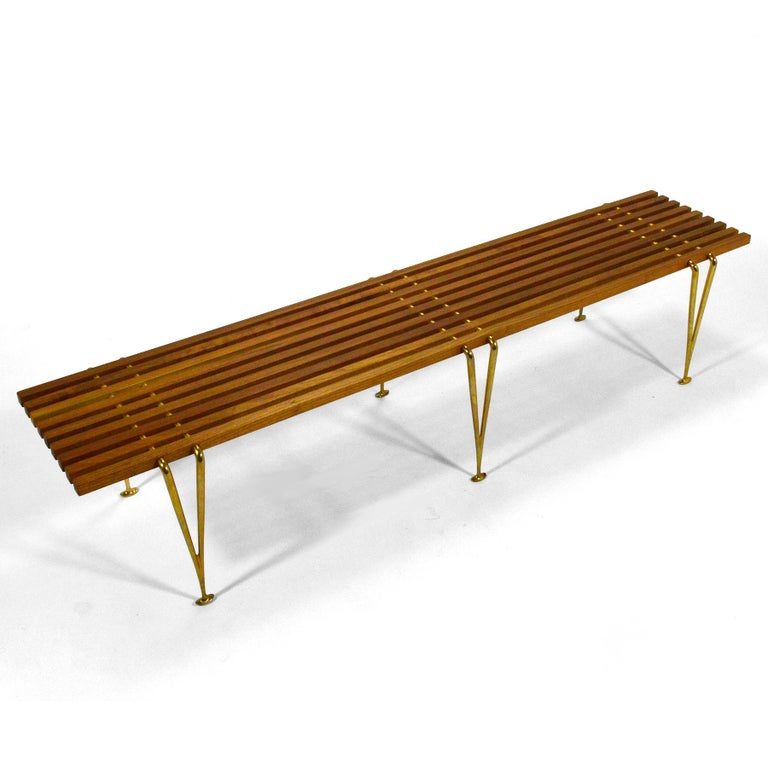 A beautiful example of an important design by artist, engineer, and designer Hugh Acton. Designed in 1954, the suspension beam bench features cherrywood slats connected to elegant cast brass legs. This example is hand signed.