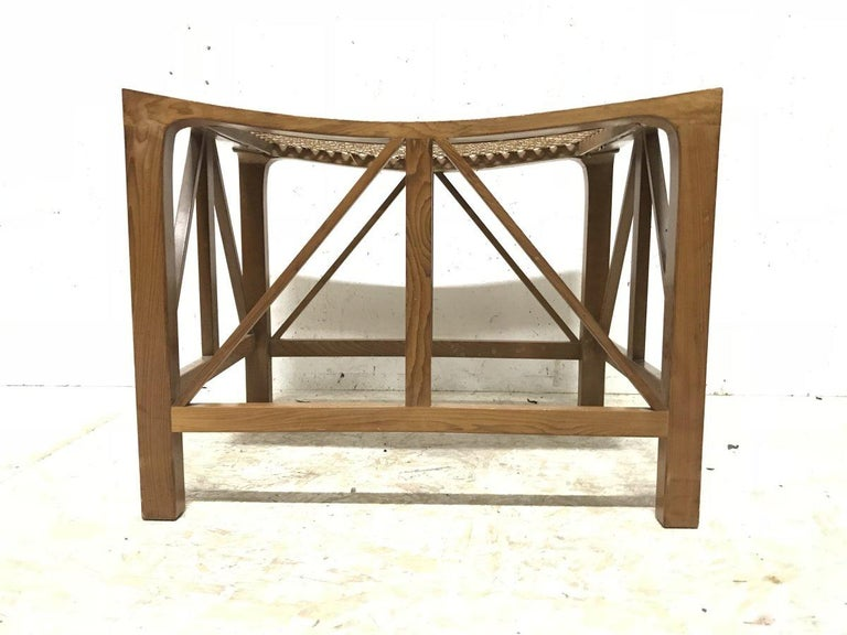 Hugh Birkett. A large handmade sculptural Yew wood Thebes stool with double wedge through tenon joints to the top on opposing sides to the cane seat. In the style of Liberty & Co. Stamped