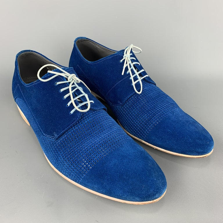 Hugo Hugo Boss dress shoes come in blue suede with a pointed toe, peforated mid panel, and stacked heel. Made in Italy.    Excellent Pre-Owned Condition. Marked: IT 42 1/2  Outsole: 11.75 x 4 in.