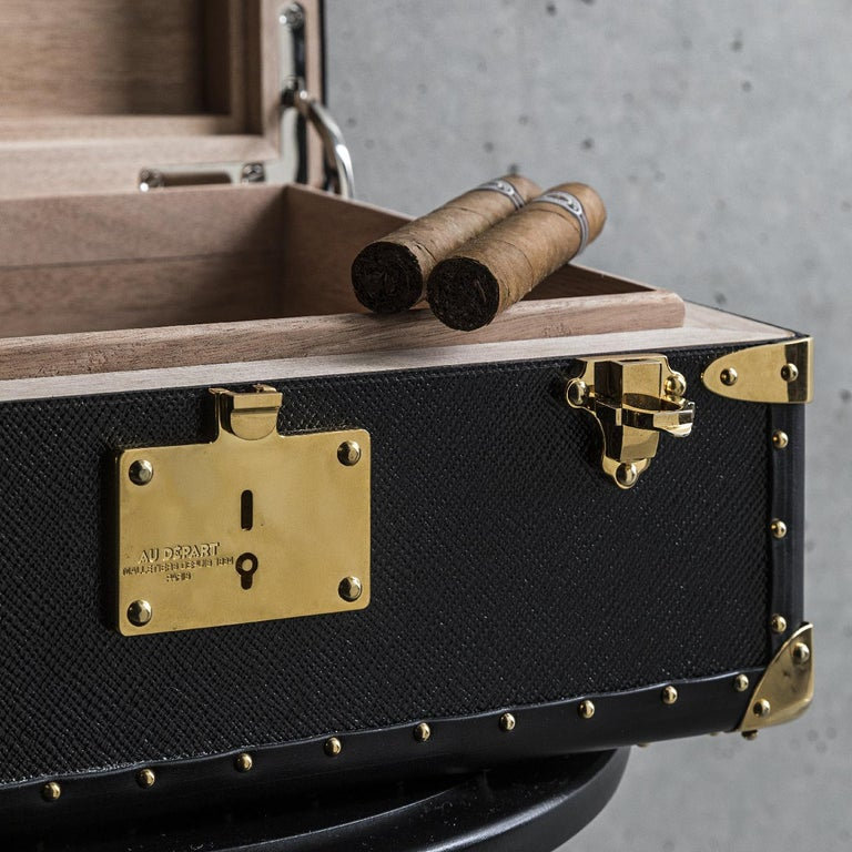 This elegant humidor is part of the Ladies & Gentlemen Collection, providing luxury and comfort when entertaining. Fashioned of wood, this elegant case boasts a traditional Silhouette and a spacious interior, offering room for 150 cigars of