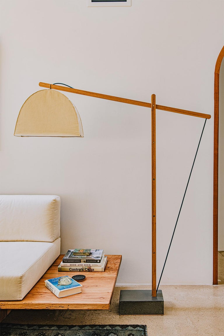 The floor lamp that charms by day and illuminates by night.   The skye lamp lifts any room's atmosphere emitting a glowing hue from its shade suspended by a structural cantilever arm that is tension adjusted for optimal lighting needs and