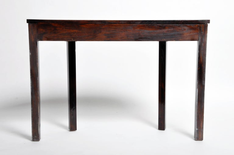 This elegant console table is from Budapest, Hungary and was made from walnut veneer, circa 21st Century. The piece features a drawer for storage. Wear and tear consistent with age and use.