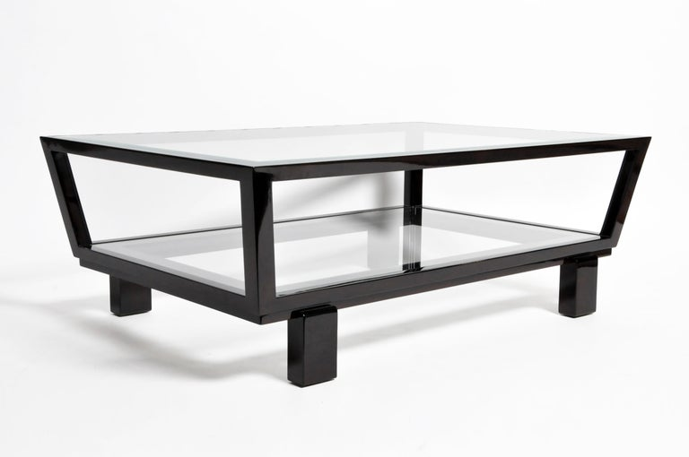This newly made elegant coffee table is from Hungary and made from solid beech wood and glass. The table features a glass top and a glass shelf underneath for storage, the table has clean beautiful lines for a modern feel.