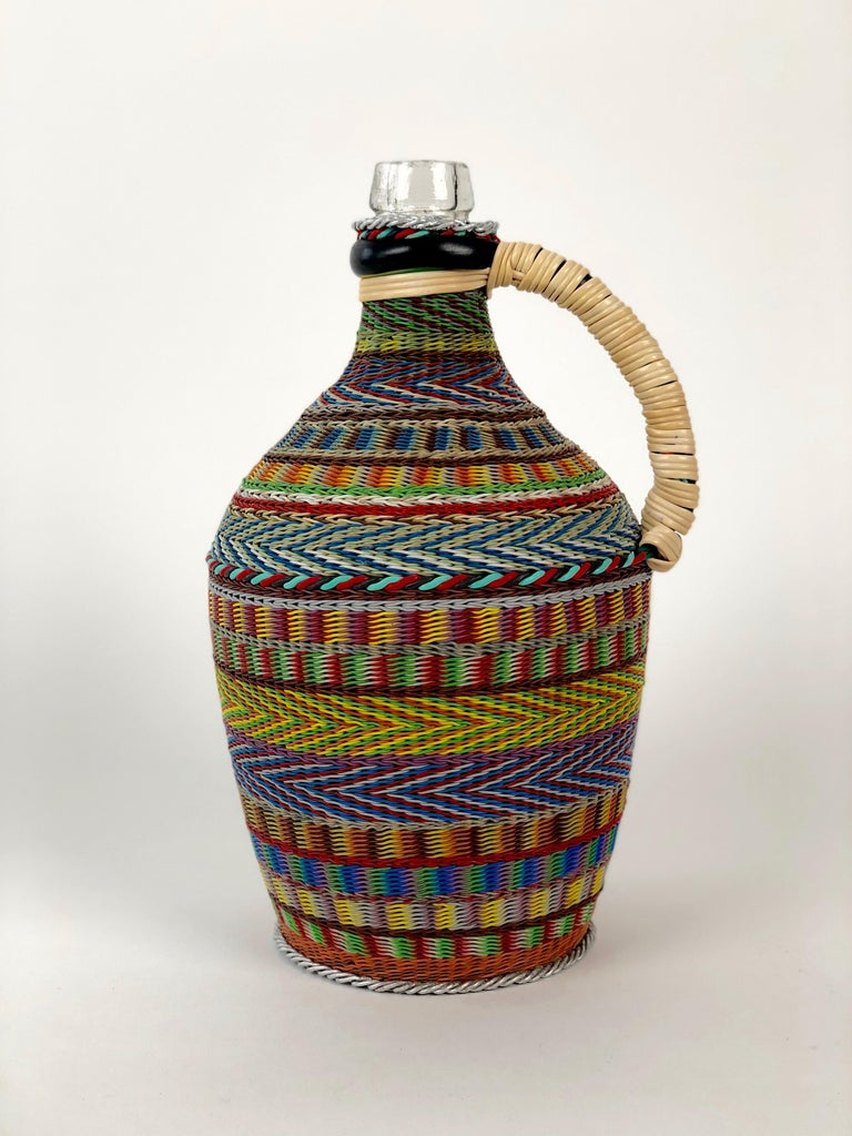Vintage woven wire decorated wine bottle. The pattern and technique are based on traditional basket  weaving. The results after many hours of work, is a unique piece of Folk Art. The woven wire bottle  was made in Hungary in the 1960's .  Today,