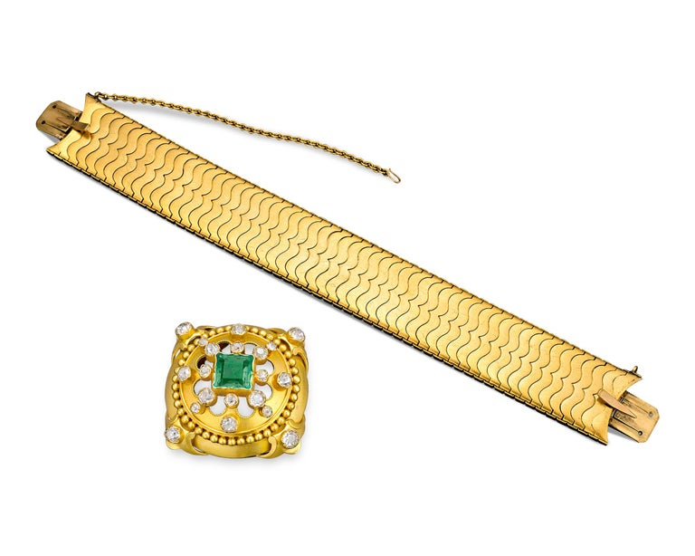 A truly splendid example of Victorian jewelry, this outstanding bracelet by Hunt & Roskell is a tour-de-force of 19th-century design. Bold and dynamic, this bracelet is comprised of a pierced central medallion that glows thanks to a square step-cut