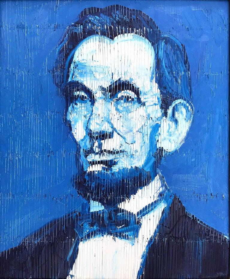 A wonderful composition of one of Slonem's most iconic subjects of Abraham Lincoln. The thick use of paint is greatly recognizable as he slathers on layer after layer of oil paint, done in blue and white. This painting is housed in a wonderful