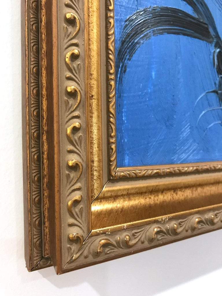 A wonderful composition of one of Slonem's most iconic subjects, Bunnies. This piece depicts a gestural figure of a black bunny on a Royal blue background with thick use of paint. It is housed in a wonderful antique style carved wood frame. Inspired