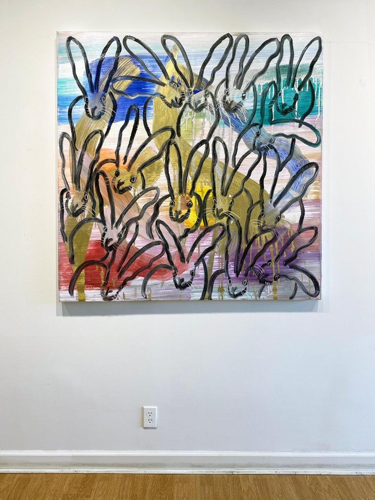 'Chinensis Vision' by Hunt Slonem, 2020. Oil on canvas, 48 x 48 in. This painting features Slonem's signature bunnies outlined in black over colorful strokes of purple, yellow, blue, green, orange and gold that are arranged throughout the white
