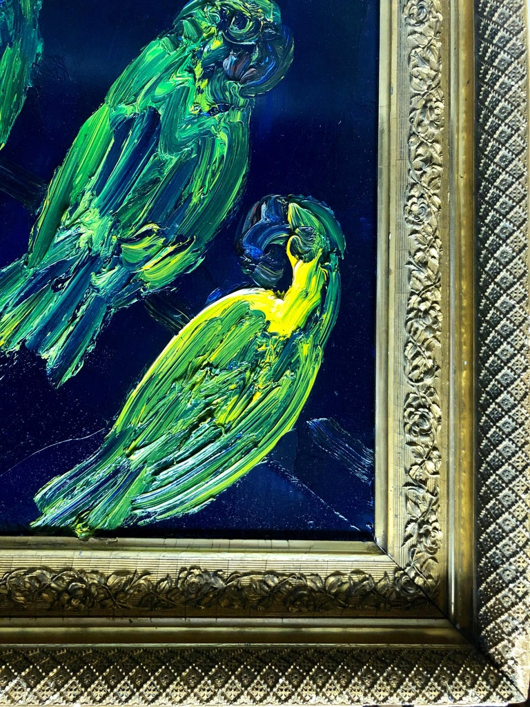 Hunt Slonem, Untitled (tropical blue and green birds on vivid blue background), 2014, oil on wood, 43x28 in. This artwork is framed in an antique gold leaf frame.  Inspired by nature, and his 60 pet birds, Hunt Slonem is renowned for his distinct