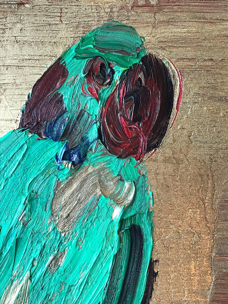 A wonderful composition of one of Slonem's most iconic subjects of a single Parrot. The thick use of paint is greatly recognizable as he slathers on layer after layer of oil paint with a golden rich background. He then draws in the green bird