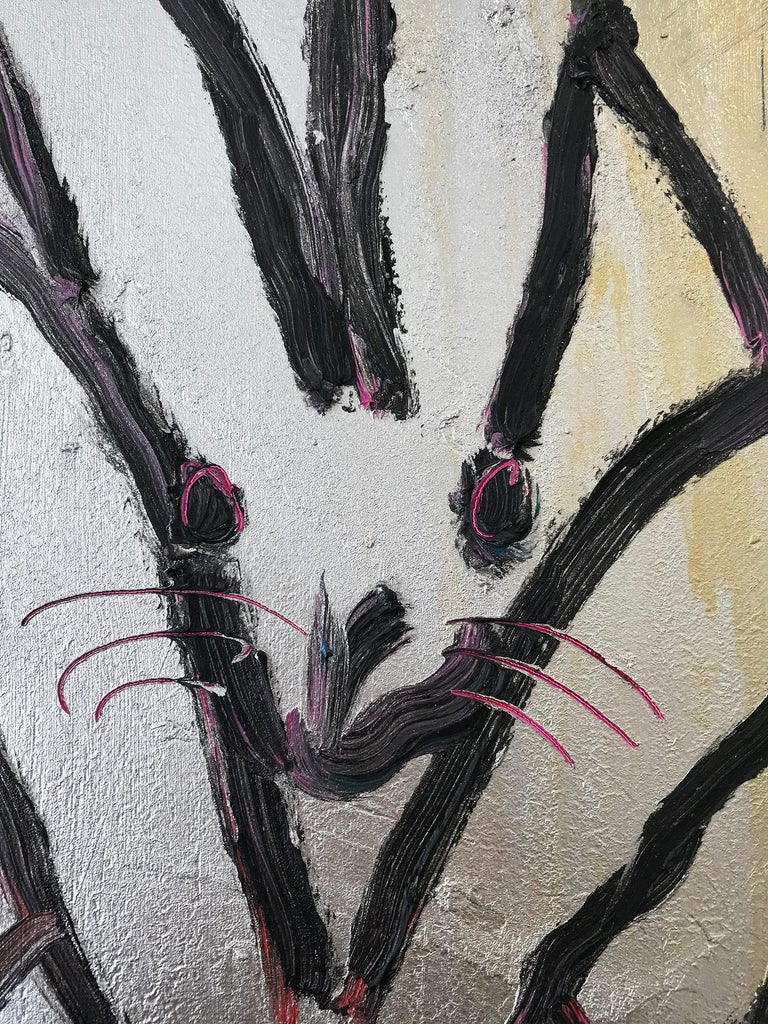 A wonderful composition of one of Slonem's most iconic subjects, Bunnies. This piece depicts 9 gestural figures of Bunnies against a gold and silver background with colorful accents.  Inspired by nature and a genuine love for animals, Slonem's