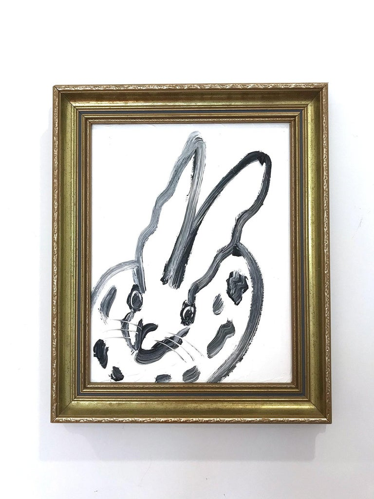 A wonderful composition of one of Slonem's most iconic subjects, Bunnies. This piece depicts a gestural figure of a black bunny on white background with thick use of paint. It is housed in a wonderful frame. Inspired by nature and a genuine love for