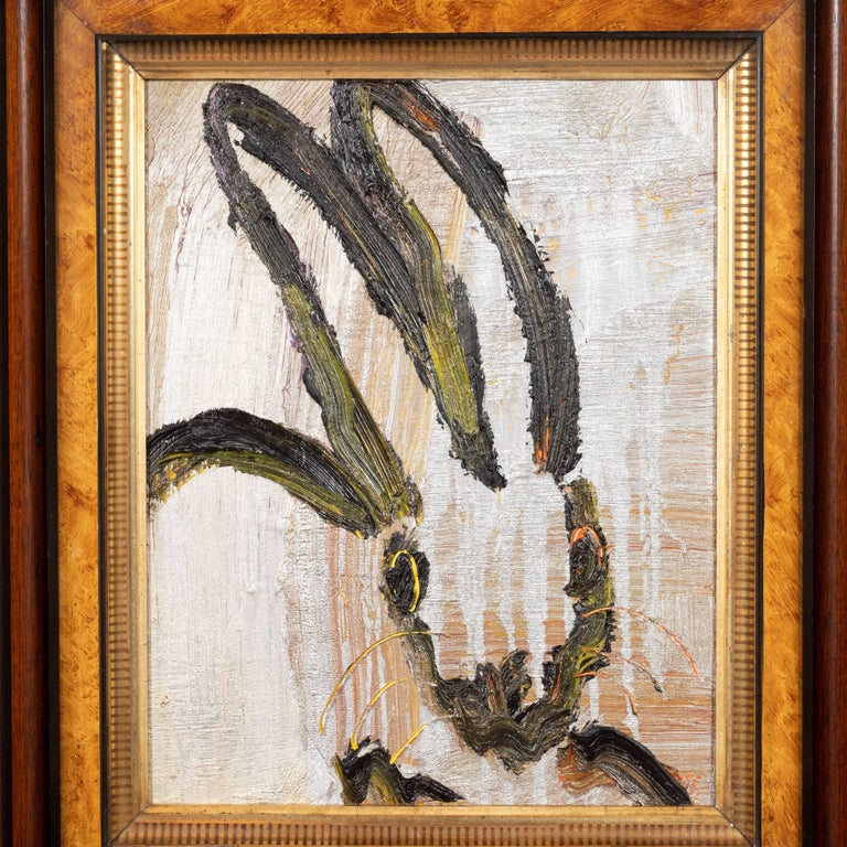 This gorgeous painting was created by the esteemed contemporary painter, Hunt Slonem in 2016. It presents a stylized rabbit whose eyes gaze directly at the viewer, rendered with loose and expressive brush strokes in black with persimmon and lemon