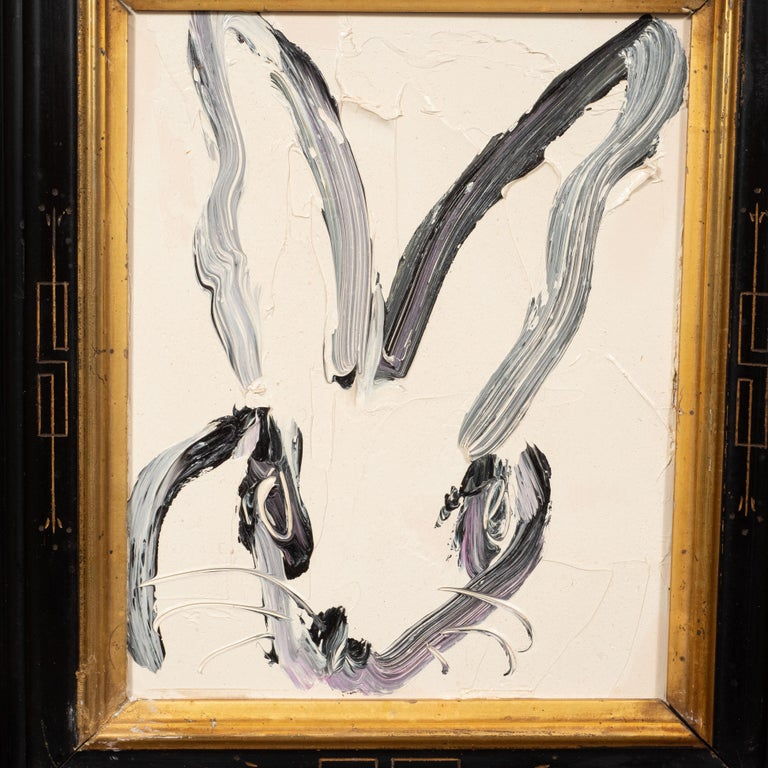 This whimsical and sophisticated painting was realized by the esteemed contemporary painter, Hunt Slonem in 2013. It presents a stylized rabbit in profile, rendered with loose and expressive brush strokes in black and white paint. Bold, graphic and