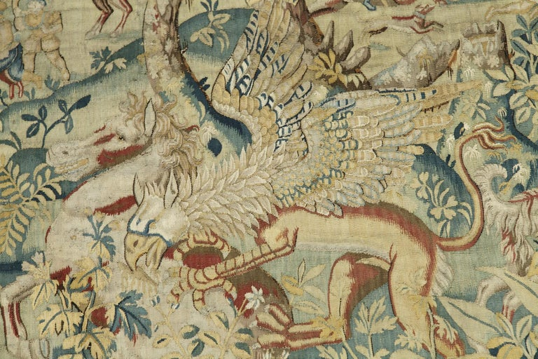 Important tapestry representing a hunting scene in the woods near a palace. Exotic and fantasy animals such as a unicorn, a griffin and a leopard are at the forefront, and the hunters and the pack at the back of the composition. An architectural