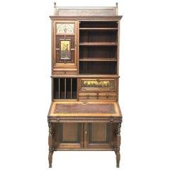 H.W. Batley Gillows & Co an Aesthetic Movement Walnut & Gilt Secretaire Bookcase