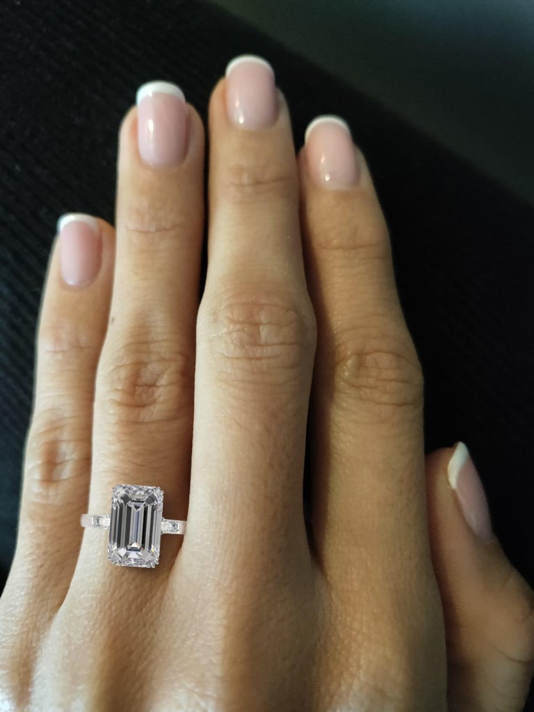 Exquisite Antinori Fine Jewels engagement ring crafted in platinum, featuring an exceptional GIA certified long emerald cut diamond weighing 3.01 carats, H color, VVS2 clarity. The ring has perfect proportions having.  This spectacular diamond
