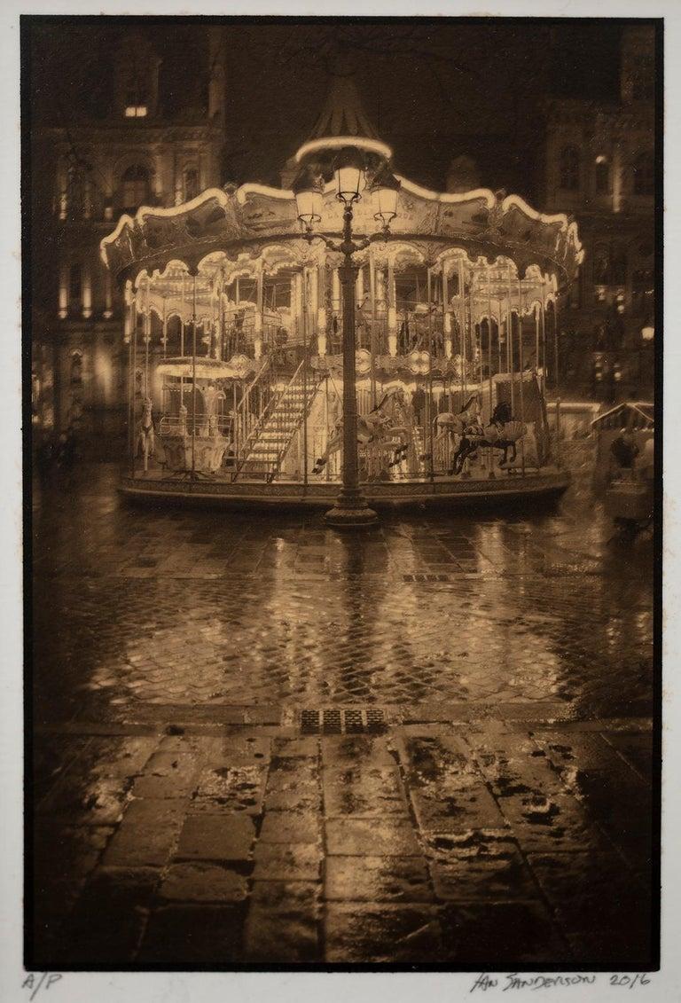 Framed Print-Carrousel-Platinum Palladium print on vellum over 24 carat gold A/P - Photograph by Ian Sanderson