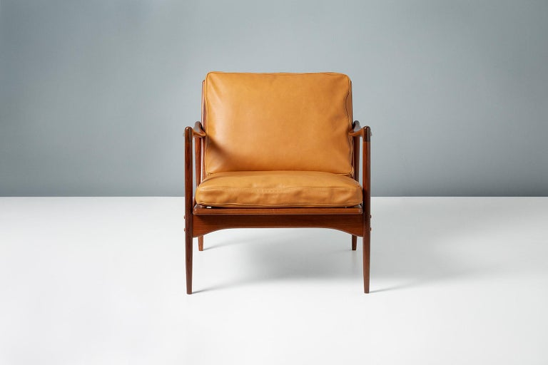 A pair of Afromosia African teak 'Kandidaten', (Candidate), lounge chairs produced by Olof Perssons Fatoljindustri (O.P.E.) in Jonkoping, Sweden, circa 1960.   Danish master Ib Kofod-Larsen gained popularity in his native Denmark in the 1950s via