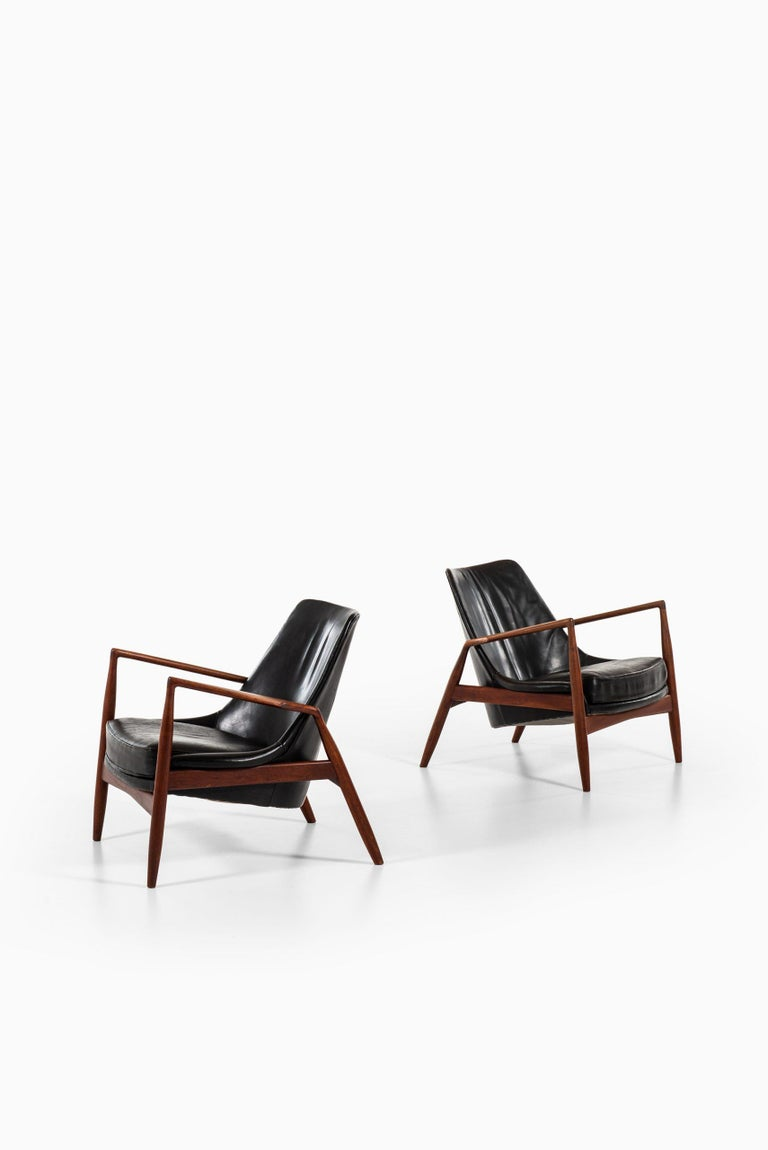 Rare pair of easy chairs model Sälen / Seal designed by Ib Kofod-Larsen. Produced by OPE in Sweden.