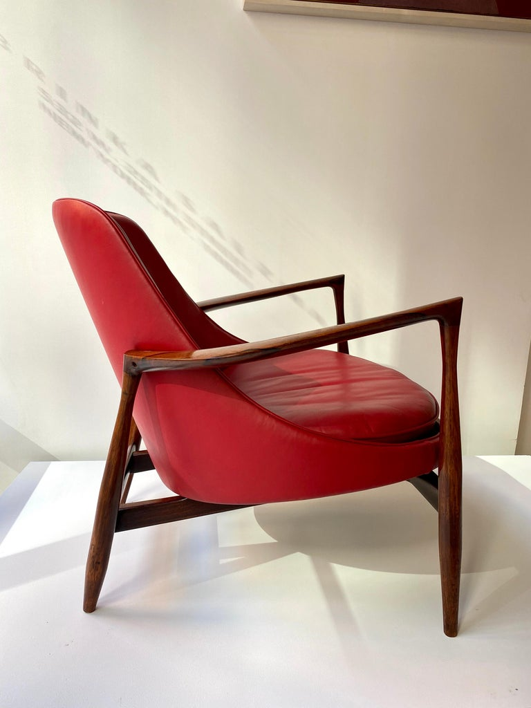 Iconic lounge chair, designed by Ib Kofod - Larsen in 1956 and produced by Christensen and Larsen, Denmark. This example is in rosewood and original red leather. It is available to view in my gallery in Chelsea, NY.