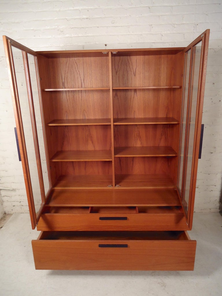 Pair of two-piece wall unit with bottom wide drawer storage and bookcase topper with glass doors. (Please confirm item location - NY or NJ - with dealer).