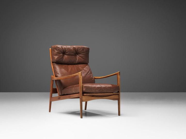 Scandinavian Modern Ib Kofod-Larsen High Back Armchair in Teak and Brown Leather For Sale