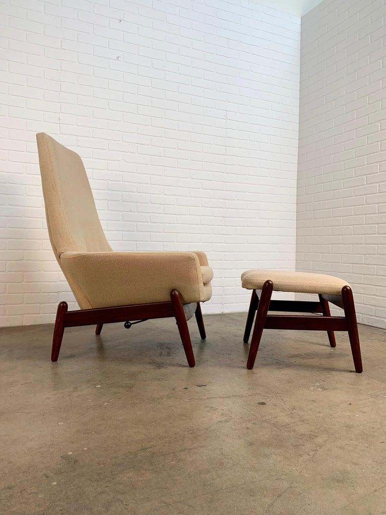 I.B. Kofod-Larsen high back recliner lounge chair with ottoman, circa 1960. Model PD30 ottoman is 23.5