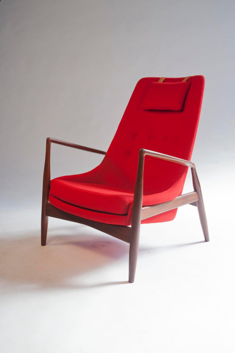 Ib Kofod-Larsen high back seal chair in Afrormosia teak and in bright red Maharam Halliingdal for OPE, Sweden, 1960s.