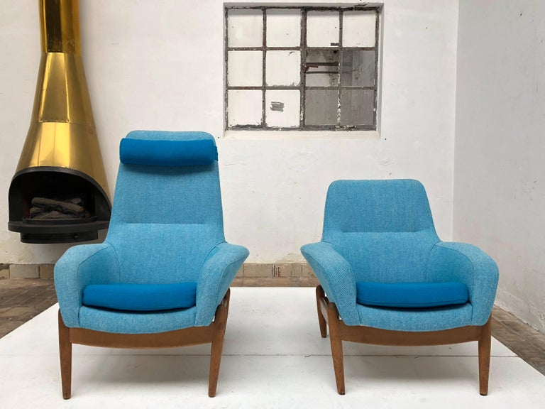 Pair of Danish design lounge chairs by designers Arnold Madsen & Henri Schubell that were distributed in the Netherlands by Bovenkamp in the 1950's and 1960's  Beautiful organic carved solid oak wood frames and newly upholstered in a Turquoise /
