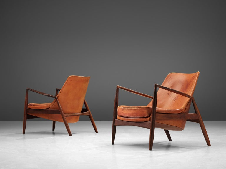 Ib Kofod-Larsen for OPE Mobler, restored pair of 'Sälen' (Seal) lounge chairs model 503-799, teak and leather, Sweden, 1956  Iconic 'Sälen' (seal) lounge chairs by Danish designer Ib Kofod-Larsen. The well-crafted frame of these chairs is made out