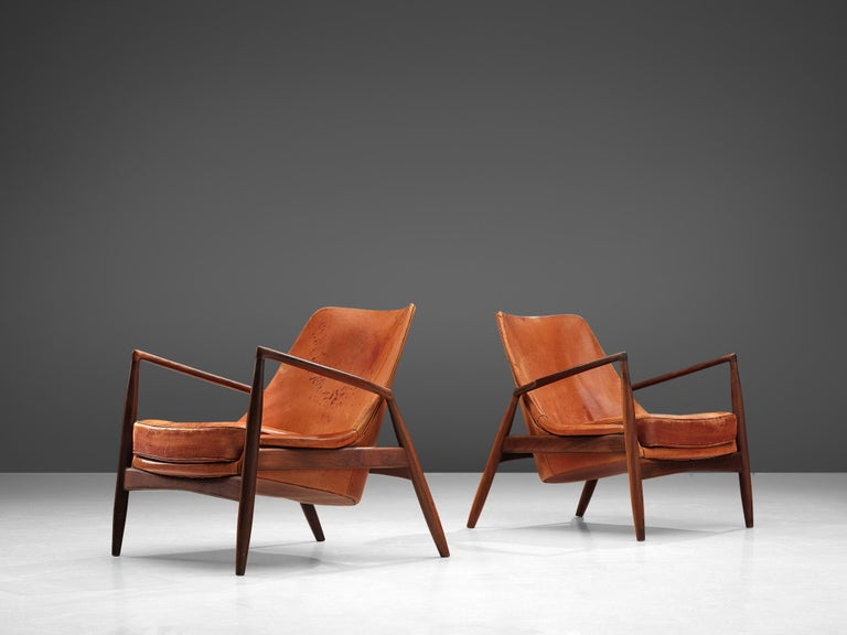 Mid-20th Century Ib Kofod-Larsen Pair of 'Seal' Chairs in Original Leather For Sale