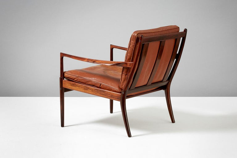 Ib Kofod-Larsen  Samso lounge chair, circa 1958.  Rarely seen lounge chair produced by Olof Perssons Fatoljindustri (OPE), Jonkoping, Sweden. Highly figured exotic rosewood frame with patinated original tan leather, down-filled cushions.