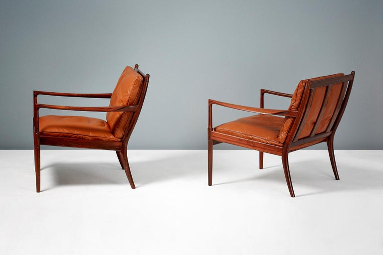 Ib Kofod-Larsen  Samso lounge chairs, circa 1958.  Rarely seen lounge chairs produced by Olof Perssons Fatoljindustri (OPE), Jonkoping, Sweden. These examples are made from highly figured exotic rosewood and come with their patinated original