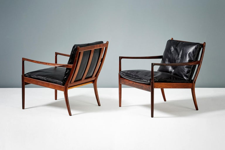 Ib Kofod-Larsen  Samso lounge chairs, circa 1958.  Rarely seen lounge chairs produced by Olof Perssons Fatoljindustri (OPE), Jonkoping, Sweden. These examples are made from highly figured exotic rosewood and come with black leather,