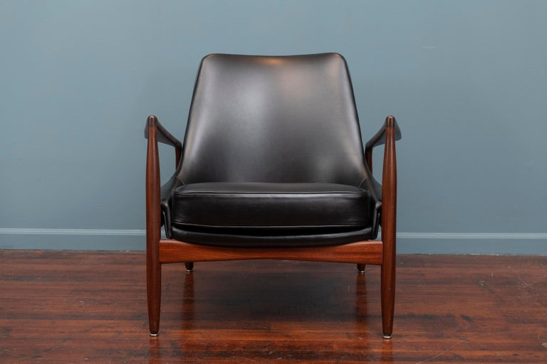 Ib Kofod-Larsen design seal chair for OPE, Denmark. Excellent original finish teak frame newly upholstered in Italian black leather, ready to enjoy.