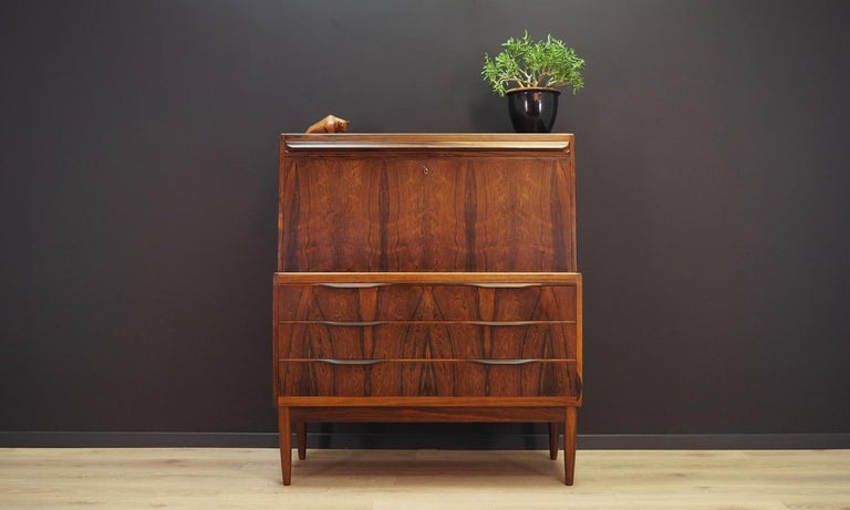 Fantastic secretary from the 1960s-1970s, Scandinavian design by Ib Kofod-Larsen. Excellent form finished with rosewood veneer. Secretary has a large writing desk and numerous drawers. Maintained in good condition (minor bruises and scratches) -