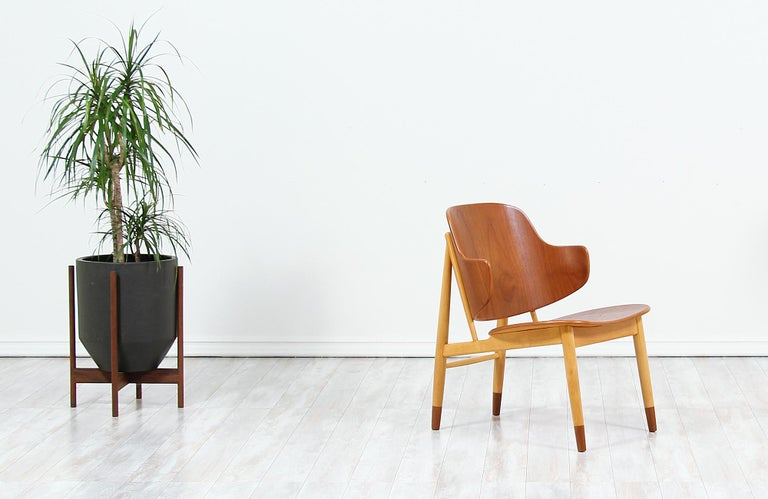 Beautiful modern shell chairs, crafted by Danish architect and furniture designer Ib-Kofod Larsen, and manufactured by Christensen & Larsen A/S in Denmark circa 1950s. This spectacular design features a sturdy beech wood frame with mounted teak bent