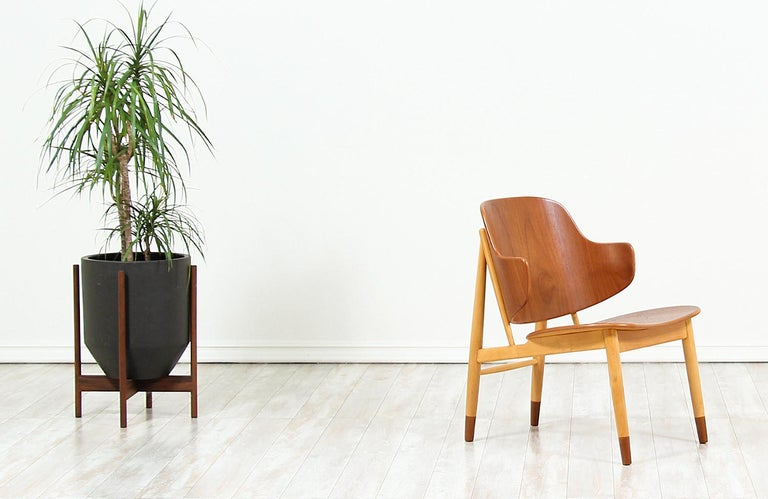 Beautiful modern shell chairs, crafted by Danish architect and furniture designer Ib-Kofod Larsen, and manufactured by Christensen & Larsen A/S in Denmark, circa 1950s. This spectacular design features a sturdy beech wood frame with mounted teak
