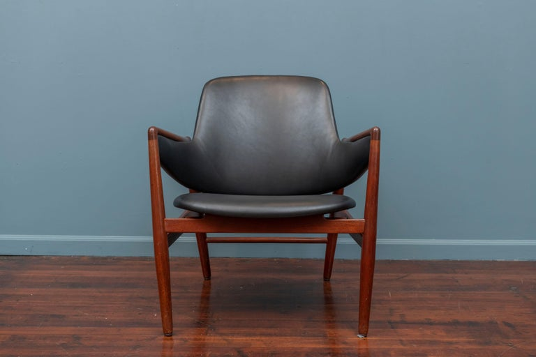 Rare Ib Kofod-Larsen design lounge chair for Christen & Larsen, Denmark. Very low production chair model, fully documented in 40 years of Danish furniture design catalog.  Newly waxed teak frame and upholstered in new black leather, very comfy and
