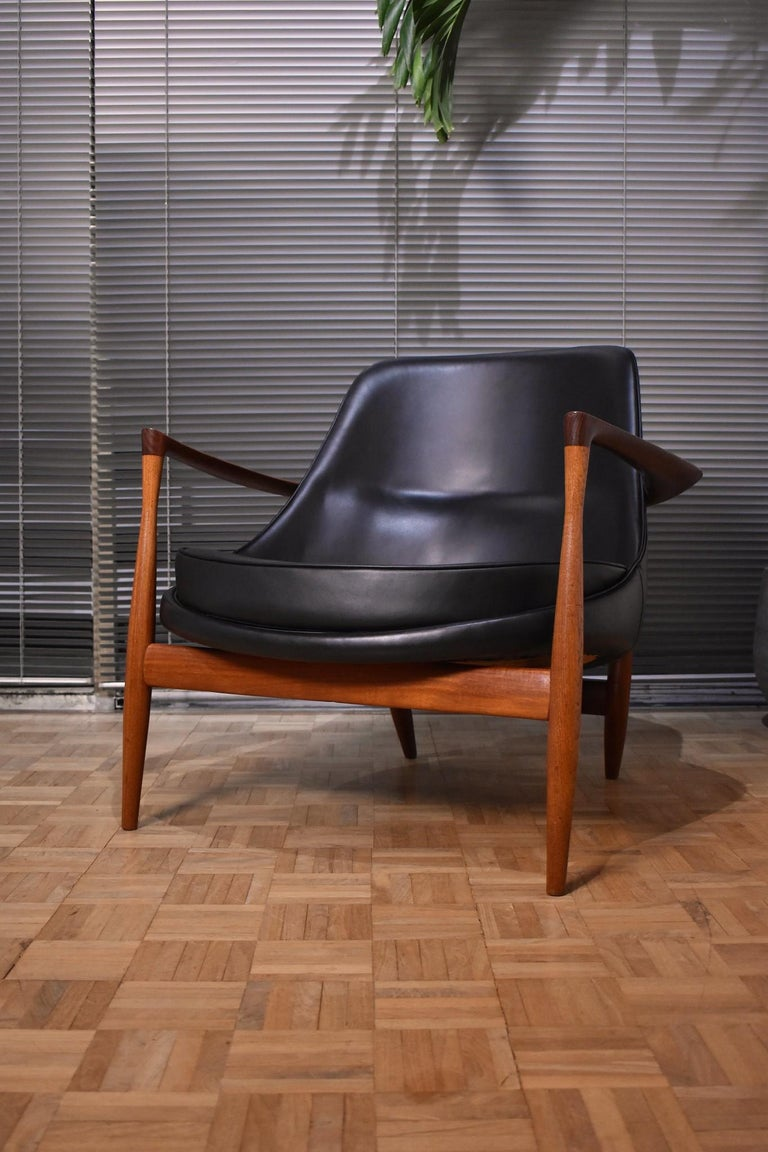 Incredibly rare and exquisitely crafted Model U-56 Elizabeth chair designed in 1956 by Ib Kofod-Larsen for cabinet makers Christensen & Larsen.  Later nicknamed the Elizabeth chair after Queen Elizabeth purchased a pair during a visit to