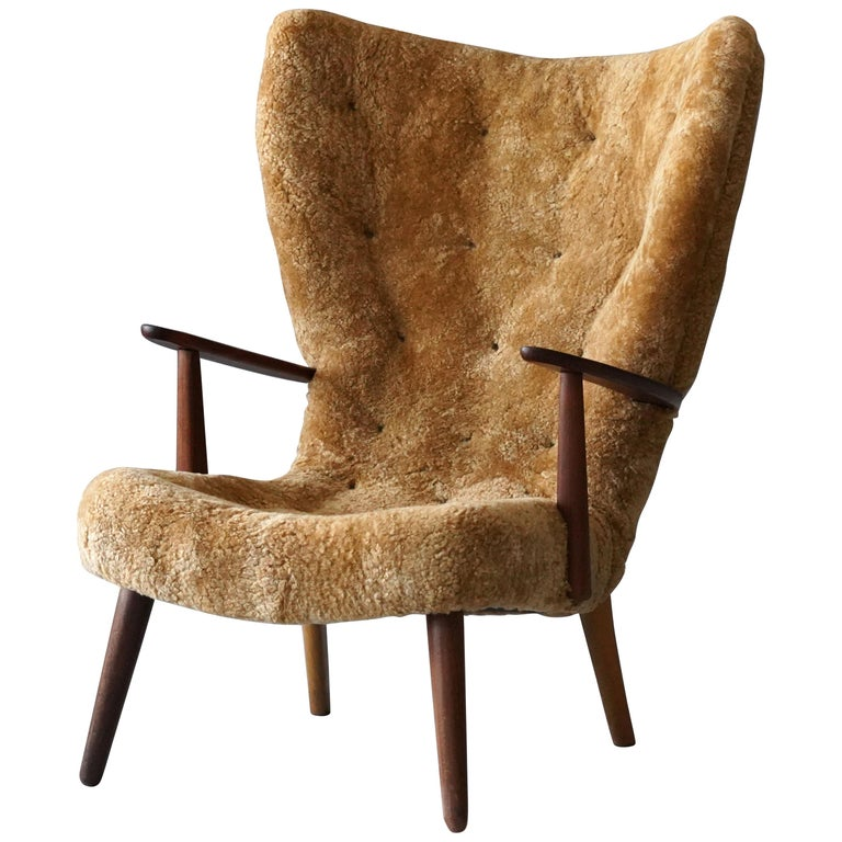 Ib Madsen & Acton Schubell sheepskin and teak lounge chair, 1950s, offered by Ponce Berga