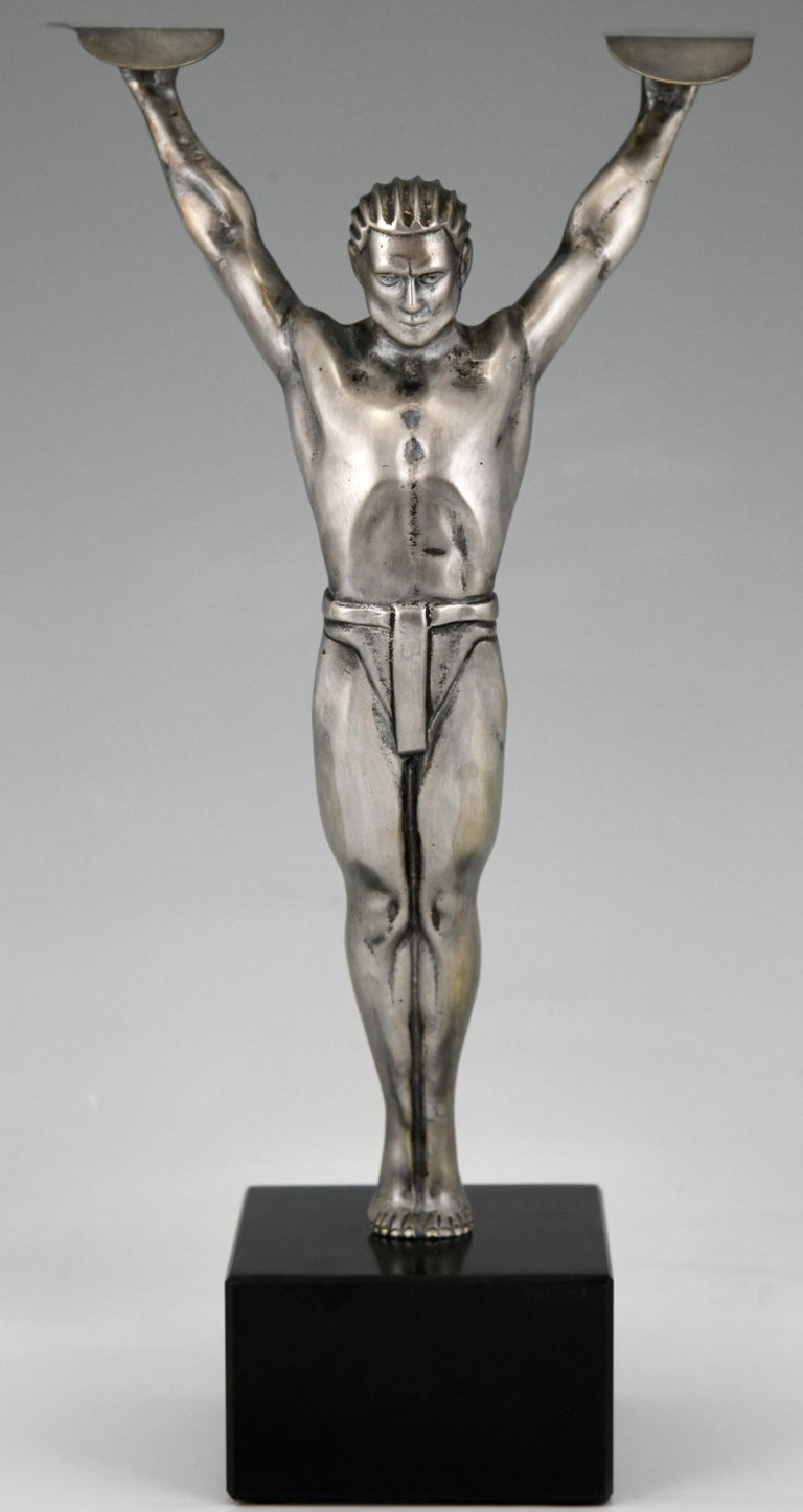 Icarus, stylish Art Deco bronze sculpture of a winged athlete in the style of Otto Schmidt Hofer Germany, circa 1930. The bronze figure has a silver patina and is mounted on a black marble base.